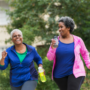 Two African-American Women Walking Outdoors - Manage Osteoarthritis - Osteoarthritis Action Alliance