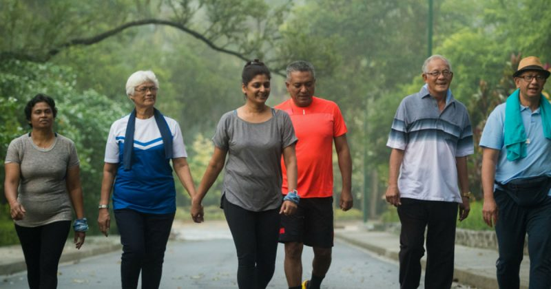 Group walking together outdoors - Living Better with Osteoarthritis - Osteoarthritis Action Alliance